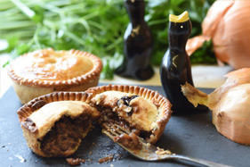 Meat pie cut open with fork