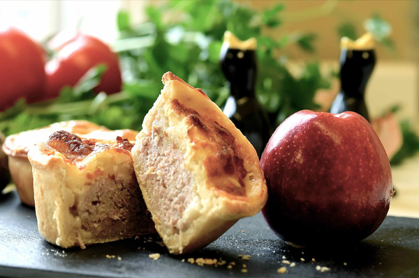 Pork pie with apple and a cheese topping