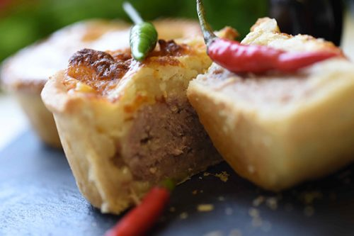 Pork pie with a hint of chilli and a cheese topping